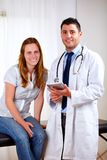 Handsome medical doctor with a young woman Stock Photography