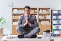 The handsome meditating on the office desk Royalty Free Stock Photos