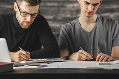 Handsome men doing paperwork Royalty Free Stock Photography