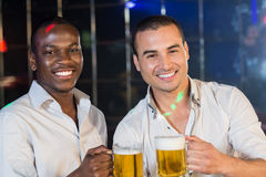 Handsome men drinking together Stock Photography