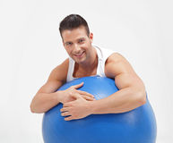 Handsome men with a fitness ball Royalty Free Stock Photography