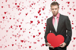 Handsome men hold big red heart Royalty Free Stock Images