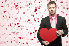 Handsome men hold big red heart Royalty Free Stock Photography
