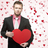 Handsome men hold big red heart Stock Images