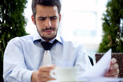Handsome men with paperwork Royalty Free Stock Images