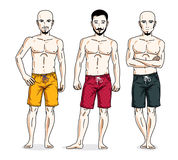 Handsome men posing with athletic body, wearing beach shorts. Ve Stock Photography
