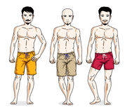 Handsome men posing with athletic body, wearing beach shorts. Ve Royalty Free Stock Photos