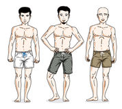 Handsome men posing with athletic body, wearing beach shorts. Ve Stock Photos