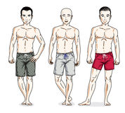 Handsome men posing in colorful beach shorts. Vector characters Royalty Free Stock Photos