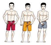 Handsome men posing in colorful beach shorts. Vector characters Stock Photos