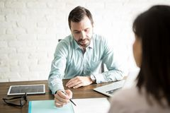 Explaining contract to a client Stock Photography