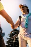 Men playing golf. Handsome men are shaking hands and smiling when meeting on a golf course Royalty Free Stock Image