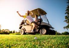 Men playing golf Royalty Free Stock Image