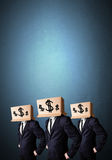 Handsome men in suit gesturing with drawn dollar signs on box Royalty Free Stock Photography