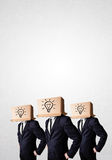 Handsome men in suit gesturing with drawn signs and symbols on b Royalty Free Stock Image