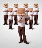 Handsome men in suit gesturing with drawn smiley faces on box Royalty Free Stock Images