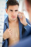 Handsome men with unbuttoned shirt Stock Photos
