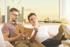 Handsome men writing in notepad Stock Images