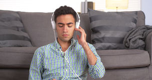 Handsome Mexican guy listening to music Royalty Free Stock Photos