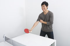 Handsome mid adult man playing table tennis Royalty Free Stock Image