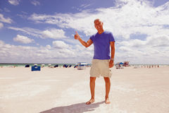 Handsome middle age man at the beach Stock Images