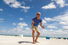 Handsome middle age man at the beach Stock Photography
