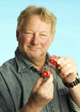 Handsome middle age man holding dice Royalty Free Stock Images