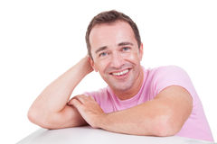 Handsome middle-age man smiling. Portrait of a handsome middle-age man smiling, on white background. Studio shot stock photo