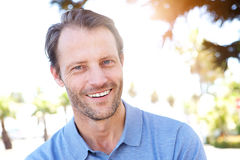 Handsome middle age man smiling outdoors. Close up portrait of handsome middle age man smiling outdoors Royalty Free Stock Photos