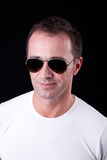 Handsome middle-age man smiling with sunglasses Stock Images