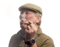 Handsome middle age man smoking cigar Stock Images
