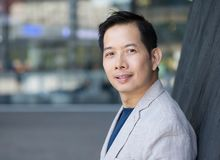 Handsome middle aged asian man Stock Photos