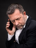 Business man speaks on a mobile phone Royalty Free Stock Image