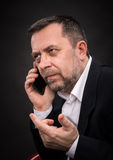 Business man speaks on a mobile phone Stock Image