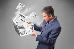 Middle aged businessman holding notebook and reading the explosi Stock Images