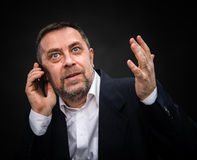 Businessman speaks on a mobile phone Stock Photos