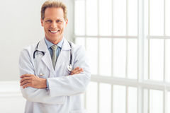 Handsome middle aged doctor Stock Photography