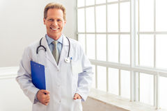 Handsome middle aged doctor Stock Image
