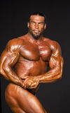 Handsome Middle-Aged Male Bodybuilder Flexes Stock Photo
