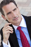 Handsome Middle Aged Man or Businessman. An outdoor portrait of handsome middle aged man or businessman dressed in a smart suit, shirt and tie Stock Photo
