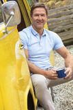 Handsome Middle Aged Man Drinking Tea or Coffee in Camper Van Bus Stock Photography