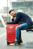 Handsome middle aged man sitting at train station Royalty Free Stock Photography