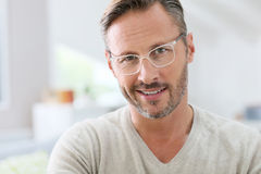 Handsome middle-aged man wearing white eyeglasses Stock Images