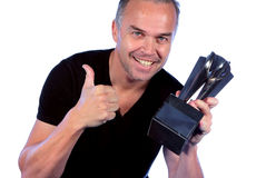 Handsome middle aged man with winners trophy. Middle aged man holding winning trophy and giving the thumbs up Royalty Free Stock Images