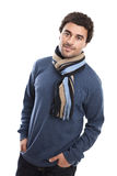 Handsome middle eastern man portrait. Portrait of a young handsome casual middle eastern man wearing sweater and scarf isolated on a white background royalty free stock images