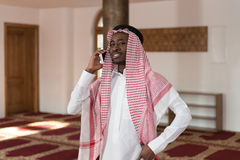 Handsome Middle Eastern Man Talking On Mobile Phone Stock Images