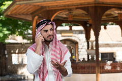 Handsome Middle Eastern Man Talking On Mobile Phone Stock Photo