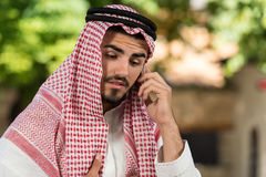 Handsome Middle Eastern Man Talking On Mobile Phone Stock Image