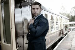 Good looking ww2 male air force officer in uniform boarding train royalty free stock image