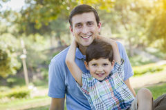 Handsome Mixed Race Father and Son Park Portrait Stock Photo